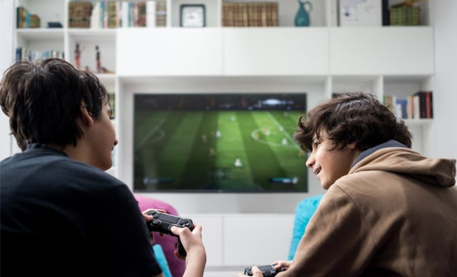 Two teen boys playing xbox